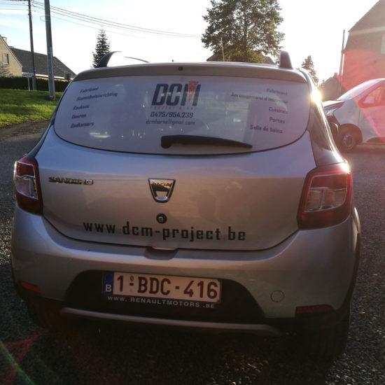 Lettrage d'une voiture pour DCM Project - Grafipix