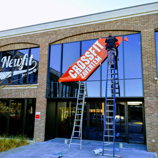 Placement du lettrage de vitrages pour Newfit - Grafipix